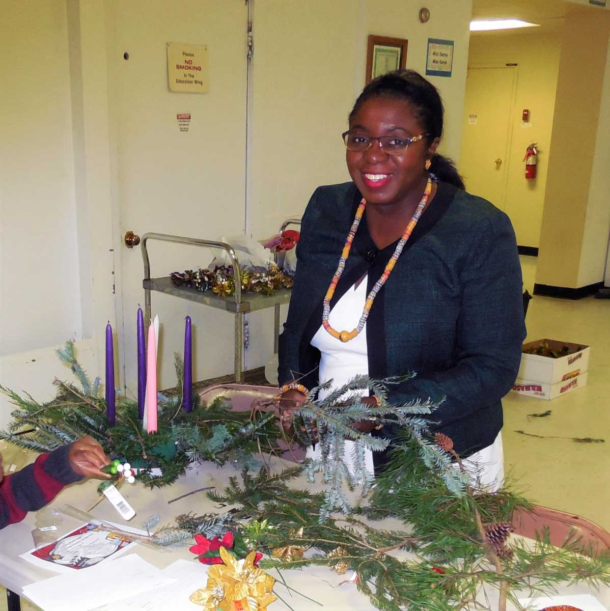 A Wesley Grove church member makes an Advent wreath during the annual Advent Wreath Workshop.